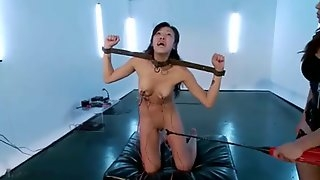 Asian slave girl gets strapon-fucked