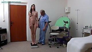Brunette girl spreads her long legs during gyno pussy exam