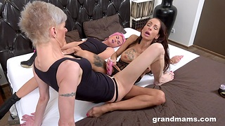 Dirty mature enjoys having sex with two younger lesbian babes